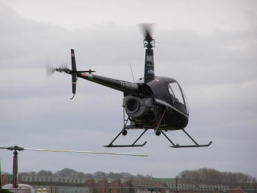 Robinson R22 Beta, G-BUBW, leaves the Museum Heliport