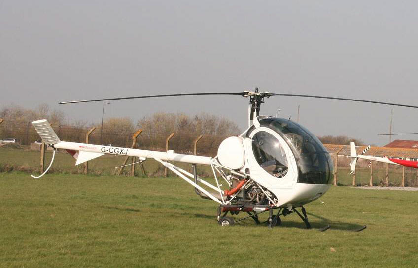 Schweizer 269C-1, G-CGXJ, at The Helicopter Museum