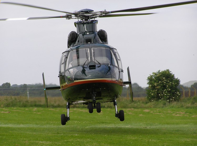AS365N-2, G-MLTY, lands at The Helicopter Museum