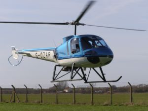 Enstrom 480, G-OZAR, lands at The Helicopter Museum