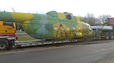 ex-Polish Air Force Mi-8P, 618, at a truckstop, in the Netherlands, en route to the UK