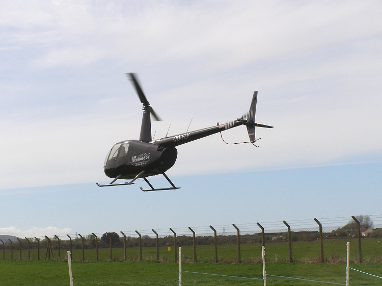 Robinson R44 Series I, OO-FLY, arrives at The Helicopter Museum on 2nd April 2011