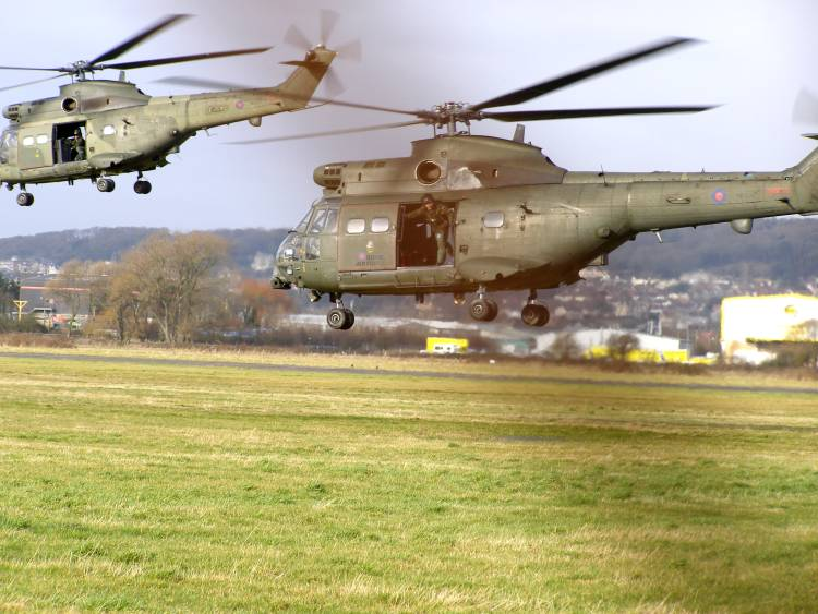 Two RAF Puma HC1s take off from the disused Weston Airport on 21st January 2009