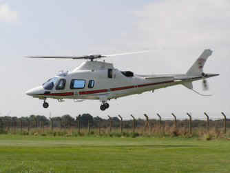 Agusta A109E, ZR321, leaves The Museum